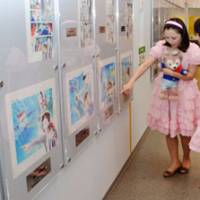 Searching for clues: Women dressed like animation characters look at drawings from the popular 'Detective Conan' series at the Gosho Aoyama Museum in Tottori Prefecture in October.