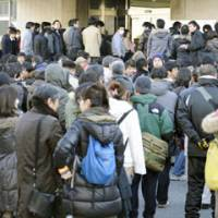 Full court: People line up at the Hiroshima District Court on Thursday to get tickets for the first session of the trial of a man who allegedly ran down 11 people at a Mazda plant in 2010. | KYODO