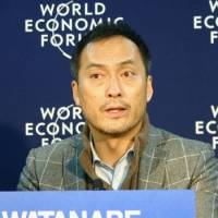 All the world's a stage: Actor Ken Watanabe faces reporters after speaking at the World Economic Forum in Davos, Switzerland, on Wednesday. | KYODO