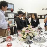 Top marks: Visitors check out Noritake Co. tableware at the Top Marques Shanghai exhibition in October. | KYODO