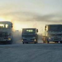 Cool runnings: Hino Motors Ltd. trucks that have been specially built to withstand extreme cold are taken on a test run Monday in Russia's Far East. | HINO MOTORS LTD. / KYODO