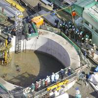 Debris clogs search: The search for five missing workers continues Wednesday morning in a flooded undersea tunnel at an oil refinery in Kurashiki, Okayama Prefecture. | KYODO