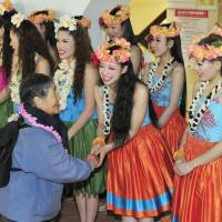 Aloha: Hula Girls at the Spa Resort Hawaiians in Iwaki, Fukushima Prefecture, greet a visitor after the resort fully resumed operations Wednesday. | KYODO