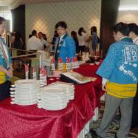 Tarnished image: Iwate officials promote rice and other food items from the prefecture during an event this week in Singapore to try to lure visitors from the city-state back to Japan. | KYODO