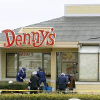 CSI Chiba?: A couple watch police probing a fatal shooting Monday at a Denny's outlet in Togane, Chiba Prefecture | KYODO