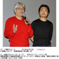 Movie message: Atsushi Funahashi (right), director of the documentary 'Nuclear Nation,' and Ryuichi Sakamoto, who composed music for the film, field questions from the audience at the Berlin International Film Festival on Sunday. | KYODO