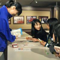 No audits: Children at KidZania Tokyo receive 'tax refunds' after filing their returns for the role-playing jobs they worked at the entertainment center in Koto Ward on Wednesday. | KYODO