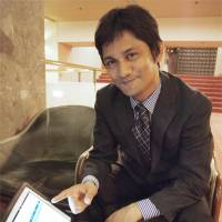 Language lord: Md Moin, founder of a firm that hires Filipinos to teach English online, shows his website. | KYODO