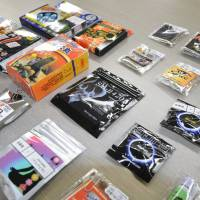 Variety pack: Quasi-legal drugs sold by Internet-based vendors are arranged for a photo in May 2011. | KYODO