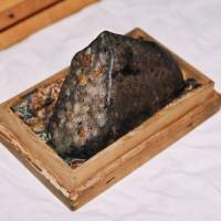 The Minamino meteorite piece enshrined at  Yobitsugi Shrine. | CHUNICHI SHIMBUN/MAKOTO KANO
