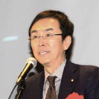 Poisoned ties: Environment Minister Nobuteru Ishihara delivers a speech Saturday in the city of Tokushima, where he referred to Beijing's reluctance to take up Tokyo's offer of technical aid to counter toxic smog. | KYODO