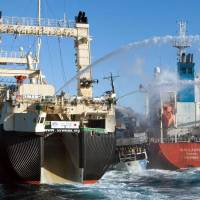 Up close and personal: The Sea Shepherd ship Bob Barker is sandwiched by two Japanese whaling vessels, the Sun Laurel and the Nisshin Maru, in a dangerous clash Feb. 25 in icy waters off Antarctica. | SEA SHEPHERD AUSTRALIA/TIM WATTERS/AFP-JIJI