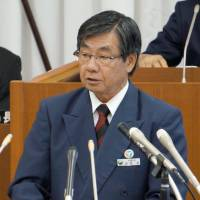 Unyielding: Mayor Susumu Inamine of Nago, Okinawa, gives his policy speech Monday before the city assembly. | KYODO