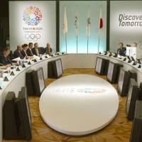 Get the ball rolling: International Olympic Committee evaluation commission members (left) and Japanese representatives, including Prime Minister Shinzo Abe (third from the podium) and Tokyo Gov. Naoki Inose (fifth from podium), meet at a Tokyo hotel Monday morning. | KYODO