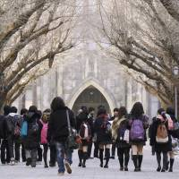 Most reputable: High school students tour the University of Tokyo campus in Bunkyo Ward in January. The institution placed ninth in this year's Times Higher Education World Reputation Rankings, remaining the most prestigious university in Asia. | KYODO