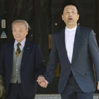 Retrial rejection: Shoji Maekawa exits the Nagoya High Court with his father, Reizo, on  Wednesday after his appeal for a retrial of his 1986 conviction over the slaying of a 15-year-old girl was turned down. | KYODO