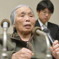 No retrial: Ayako Haraguchi speaks to reporters Wednesday in the city of Kagoshima after the Kagoshima District Court rejected her appeal for a retrial in a 1979 murder case. | KYODO