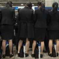 Trying to get ahead: College women attend a job fair at Makuhari Messe in the city of Chiba in December 2011. | BLOOMBERG