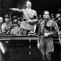 Sieg Heil: Adolf Hitler salutes a parade in Berlin in 1938 as Rudolf Hess, deputy head of the Nazi Party, looks on. | AP/KYODO