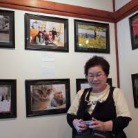 Featured: Takako Matsumura poses at the photo exhibition 'A Treasure Box of Otsuchi' on Friday at Gallery Yasashii Yokan in Shinagawa Ward, Tokyo. The show runs till Monday. | SATOKO KAWASAKI