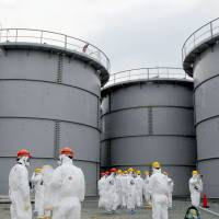 Long way from OK: Storage tanks filled with radiation-tainted water are shown to the press during a tour of the Fukushima No. 1 power plant on March 1. | POOL