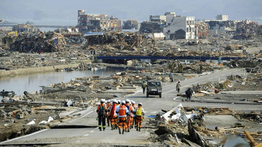 After and before: A coastal district of Minamisanriku in Miyagi Prefecture is seen March 2, ahead of the second anniversary of the Great East Japan Earthquake, and on March 13, 2011, two days after the area was leveled by massive tsunami spawned by the 9.0-magnitude temblor.