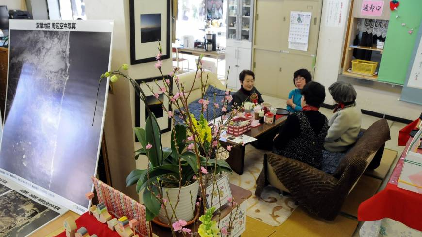 Some of the 140 evacuees from Futaba, Fukushima Prefecture, relax in a makeshift tea room set up in the former Kisai High School building in Kazo, Saitama Prefecture.