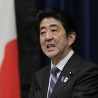 Man with the plan: Prime Minister Shinzo Abe speaks at a news conference on the second anniversary of the Great East Japan Earthquake at his office in Tokyo Monday. | AP