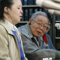 Vote of confidence: Takumi Nagoya faces reporters Thursday in Tokyo with her father looking on. | KYODO