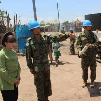 Ground floor: Tetsuko Kuroyanagi, a well-known actress and UNICEF goodwill ambassador, listens as a Ground Self-Defense Force officer explains his team's efforts to build roads in South Sudan's capital, Juba, on Friday. | KYODO
