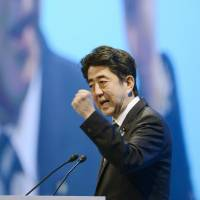 Read my lips: Prime Minister Shinzo Abe addresses the Liberal Democratic Party's annual convention in Tokyo on Sunday. | KYODO