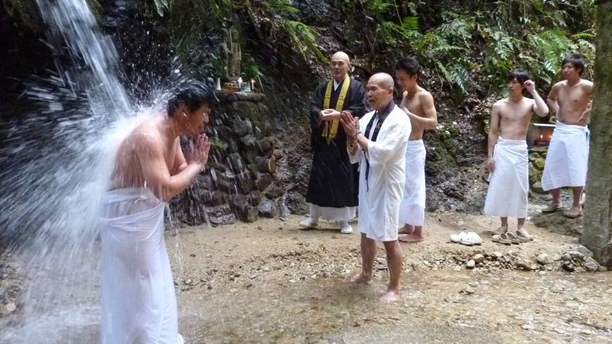 Students perform cold-water ablutions under a waterfall at Shokoji Temple in Kawachinagano, Osaka Prefecture, in December.