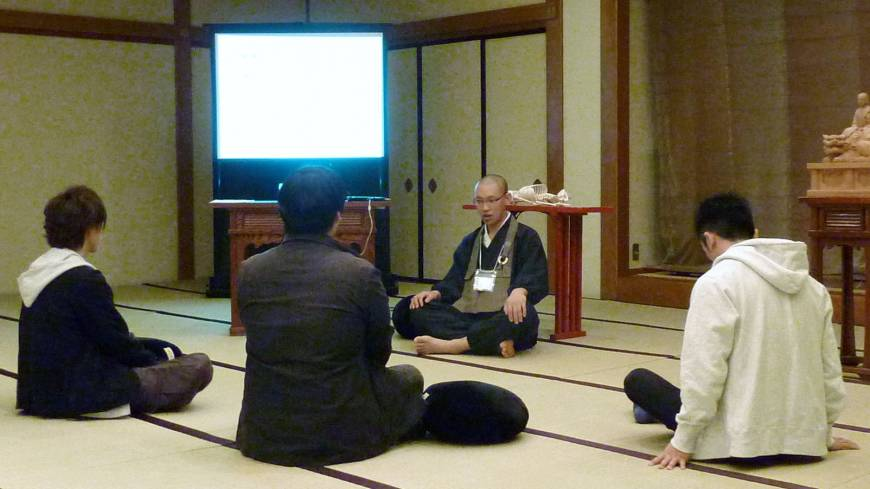 One with the universe: Job-hunting university students learn Zen meditation techniques from a Buddhist priest at a Tokyo hotel in December.