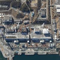 In an aerial photo Fukushima No. 1 nuclear power plant, the location of the power failure is shown in the top right corner.  | KYODO