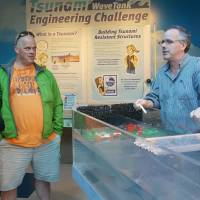 Show and tell: Mark Farley, visitor center manager at the Hatfield Marine Science Center of Oregon State University in Newport, briefs visitors about the facility's tsunami simulator in February. | KYODO