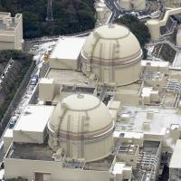 Running: Reactors 3 (above) and 4 of the Oi power plant in Fukui Prefecture are seen in February. | KYODO