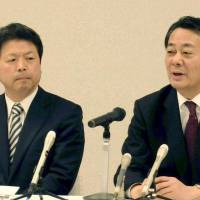 Party plug: Democratic Party of Japan leader Banri Kaieda speaks during a news conference Thursday while former Justice Minister Hideo Hiraoka looks on in the city of Yamaguchi. | KYODO