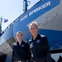 At ease: Sea Shepherd's Operation Zero Tolerance leader, Bob Brown (right), stands Wednesday in front of the Bob Barker in Melbourne. | SEA SHEPHERD AUSTRALIA/GLENN LOCKITCH/AFP-JIJI