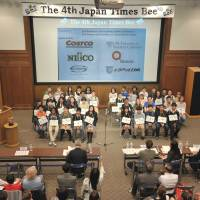 Crunch time: Participants in The 4th Japan Times Spelling Bee pose for a group photo before Saturday's contest kicked off Saturday at the newspaper's headquarters in Minato Ward, Tokyo. | YOSHIAKI MIURA