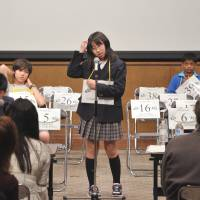 Word play: Honoka Onuki, 12, scratches her head as she tries to recall a spelling. | YOSHIAKI MIURA