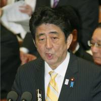 Pressured: Prime Minister Shinzo Abe speaks in a Lower House Budget Committee session Thursday. | KYODO