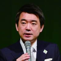 Crowd pleaser: Nippon Ishin no Kai cochief Toru Hashimoto talks at the party's inaugural convention Saturday in Osaka. | KYODO