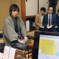 Checkmated: Shinichi Sato, a professional 'shogi' player, is seen after losing to the Ponanza computer program on Saturday in Shibuya Ward, Tokyo. | KYODO