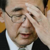 Helm change: Departing Bank of Japan Gov. Masaaki Shirakawa gives his last news conference as BOJ chief Tuesday in Tokyo.  | AFP-JIJI