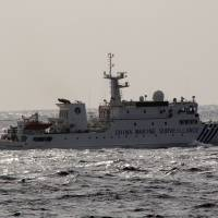 Cat, mouse: The Chinese marine surveillance ship Haijian 8002 is seen by the Japan Coast Guard near the Senkaku islets in the East China Sea on March 16. |  JAPAN COAST GUARD/AFP-JIJI