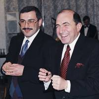 Merchant princes: Boris Berezovsky (right) poses for a photo with fellow Russian tycoon Mikhail Khodorkovsky in Moscow.  | AP