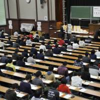 The way forward: Students sit for a national examination to gain admission to the elite University of Tokyo on Saturday. | KYODO