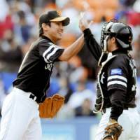 Fukuoka Softbank right-hander Shota Oba high-fives catcher Hidenori Tanoue after the Hawks' 3-0 win over Chiba Lotte on Saturday. The rookie notched his second shutout of the season, striking out 16 batters. | KYODO PHOTO