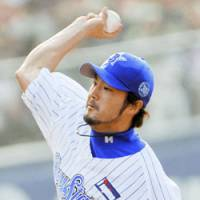 Long time coming: BayStars hurler Hayato Terahara, who usually starts for Yokohama, earned his first save in over six years after making a rare relief appearance in the Baystars' 3-1 win over the Hiroshima Carp on Sunday. | KYODO PHOTO