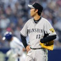 Bad day: Tigers starting pitcher Satoru Kanemura gives up a homer to Chunichi's Kazuhiro Wada in the seventh inning at Nagoya Dome on Sunday. Kanemura gave up seven runs in five innings as Hanshin lost to the Dragons 7-6. | KYODO PHOTO